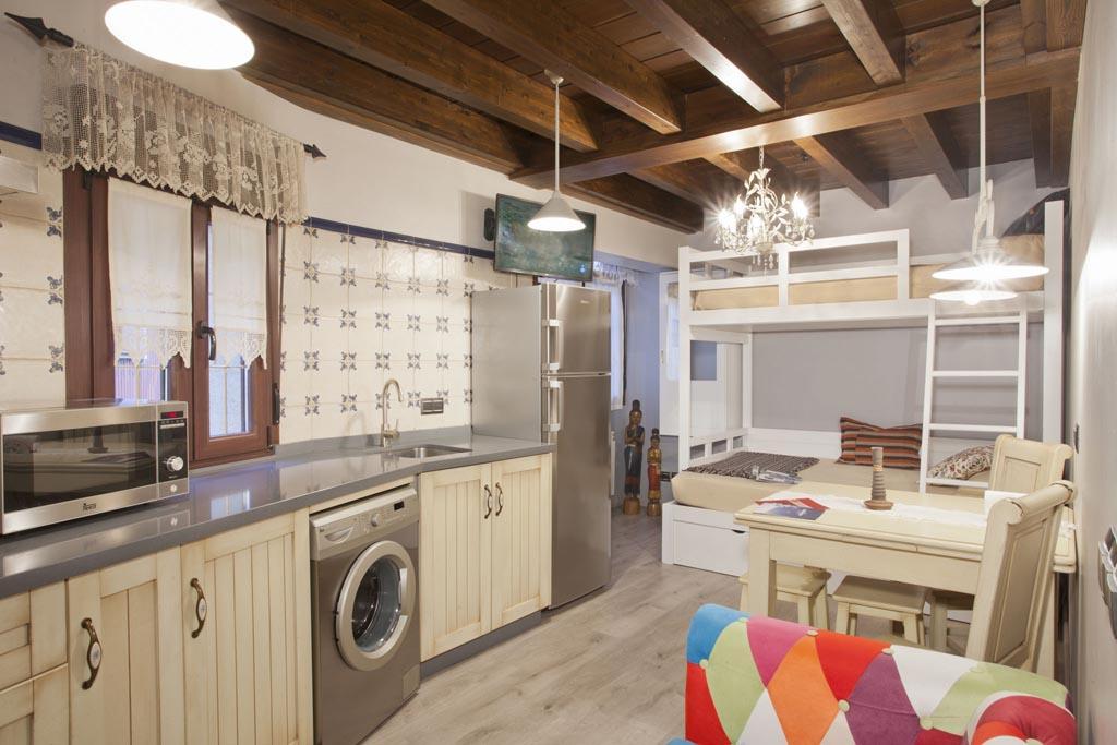 Salón cocina con litera. Apartamento Trichuru.
